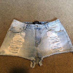 Mink Pink high rise destroyed denim shorts - med